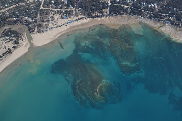 A large reef is visible in this aerial shot; can you spot Blue Breezes?